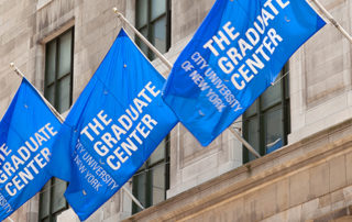 image shows Graduate Center building with GC flags